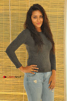 Actress Bhanu Tripathri Pos in Ripped Jeans at Iddari Madhya 18 Movie Pressmeet  0036.JPG