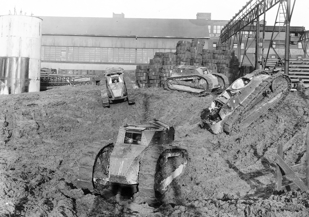 Testing tanks in the mud. Original caption: Mud hole in testing field at van Dorn Iron Works Company in Cleveland, Ohio.