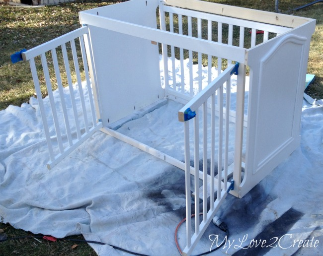 painting dog crate made from an old crib