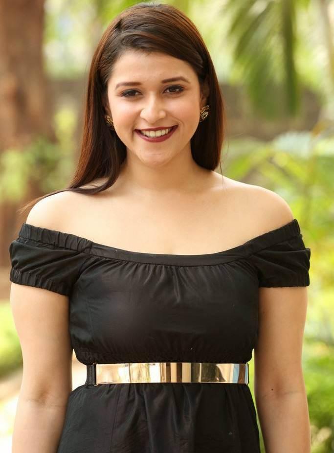 Beautiful Telugu Girl Mannara Chopra Long Hair In Mini Black Dress
