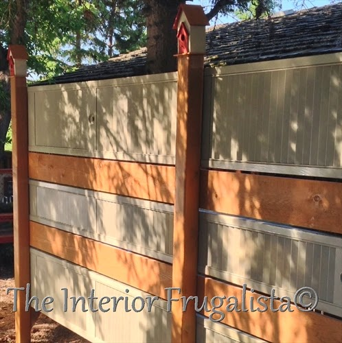 A budget-friendly DIY Privacy Fence or Garden Screen idea made with salvaged and repurposed wooden louvered bi-fold doors, a unique outdoor fence idea.