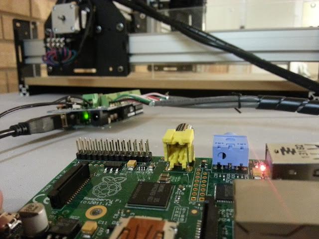 Closeup of raspberry pi with CNC machine in background