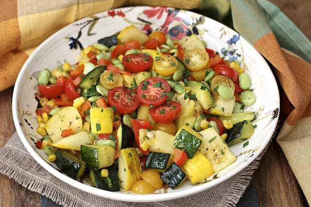 Summer Squash Succotash.  This classic Southern veggie dish is updated with the wonderful flavors of summer squash and fresh tomatoes.