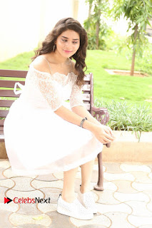 Actress Tejaswini Pictures in White Dress at Lachhi Teaser Launch  0162.JPG