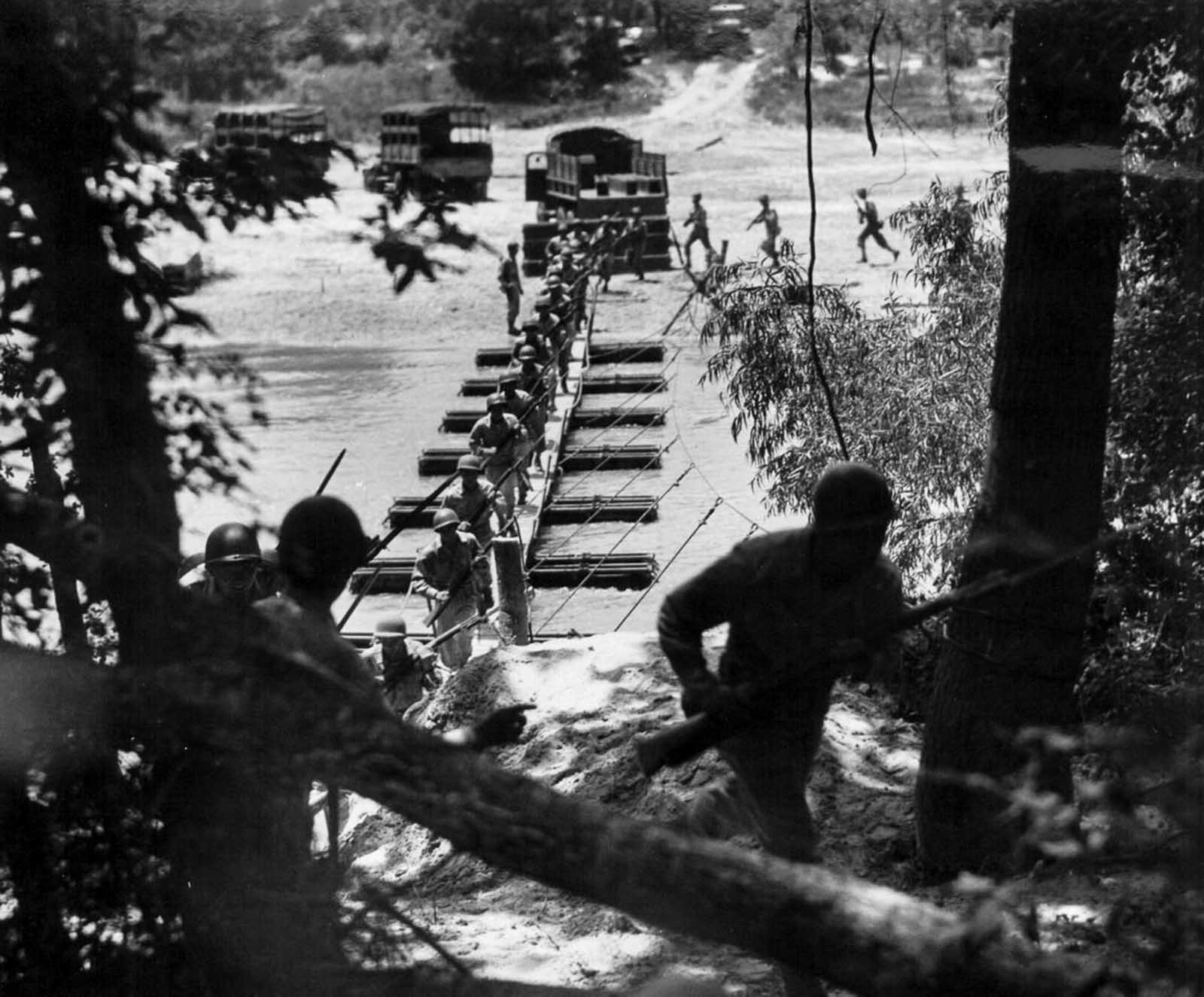 Soldiers of the 442nd train in building and attacking across a pontoon bridge. July, 1943.