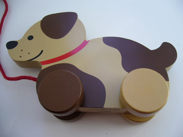 Wooden dog toy for Operation Christmas Child shoeobox.