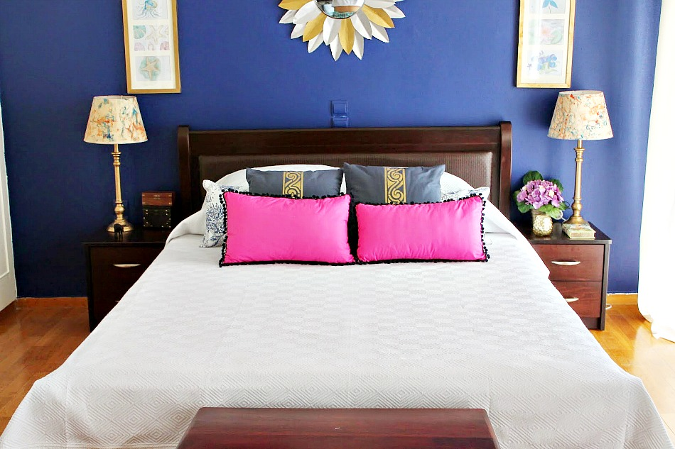 White duvet cover blue pillows with gold stencil and pink pillows
