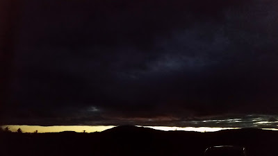 Mt. Monadnock at sunset with ominous dark clouds