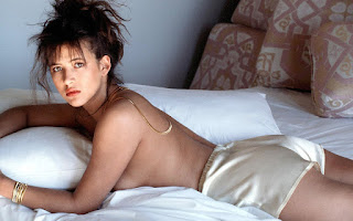 Sophie Marceau Laid On Bed With No Bra
