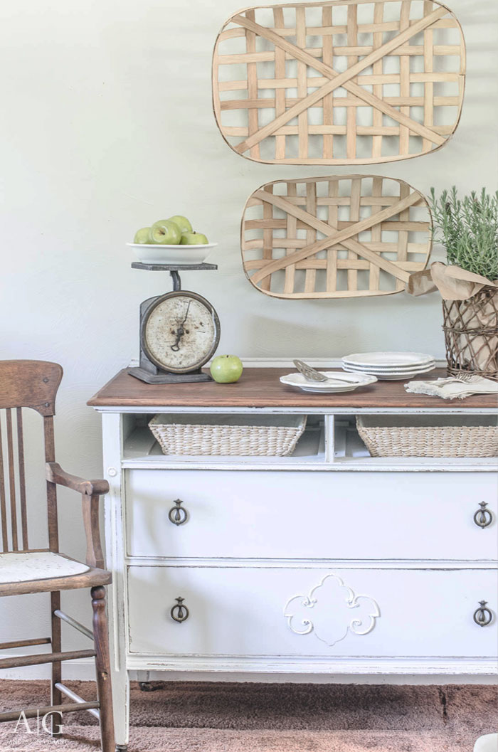 You'll love this farmhouse furniture before and after where a vintage dresser that was missing a drawer was transformed into a unique dining room sideboard. |  www.andersonandgrant.com