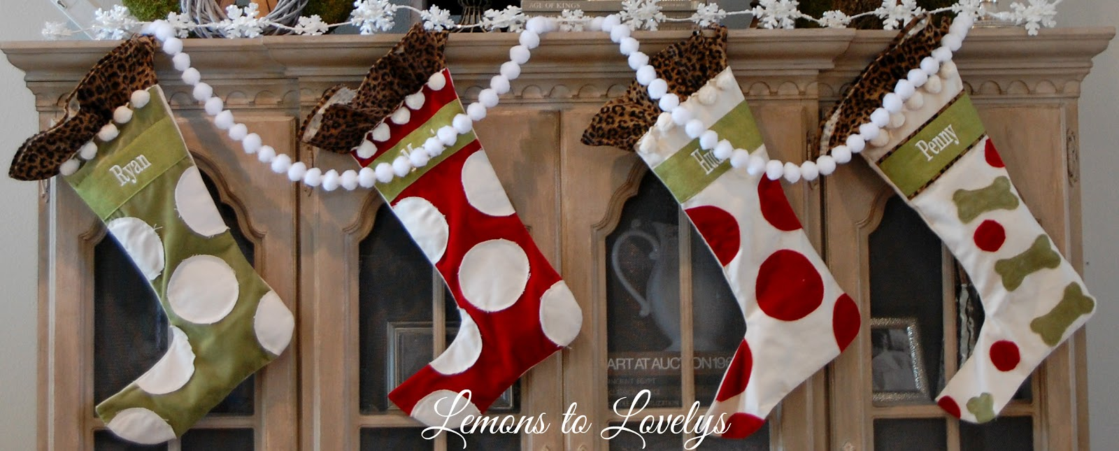 christmas 2015 entryway lemons to lovelys i couldn t hang our stockings on the fireplace mantle this year because a certain someone could pull them down so the china cabinet was the safest place
