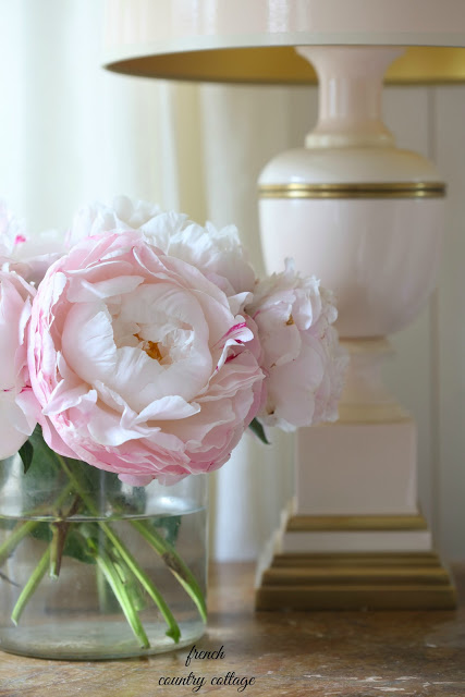 peony on nightstand with blush lamp