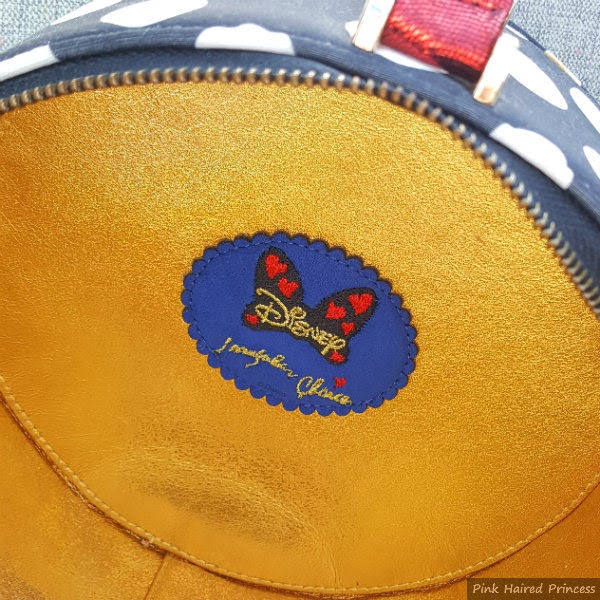 gold lining inside handbag with Disney bow and Irregular Choice branding