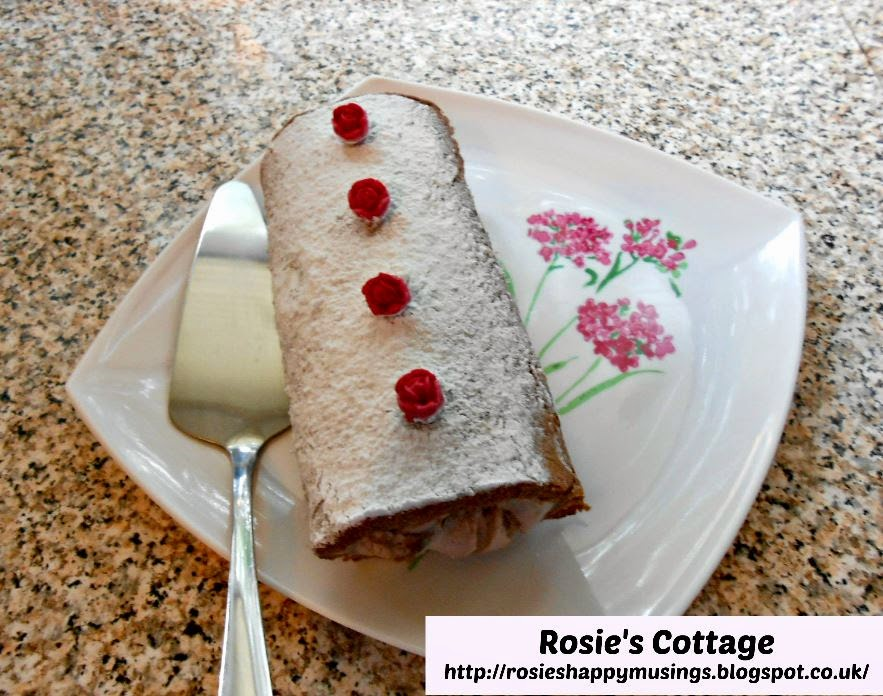 Chocolate Swiss Roll with roses