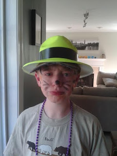 sad boy in tiger face paint