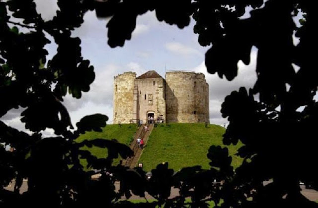 Archaeologists investigate mound beneath historic tower