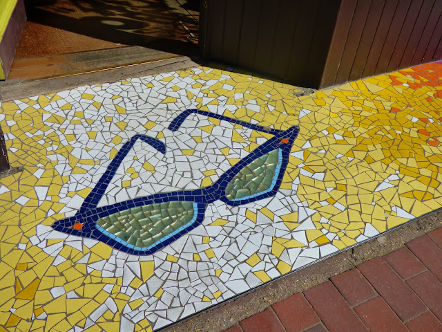 Glasses mosaic outside an opticians in The Laines, Brighton