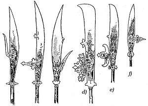 A series of long, thick spear heads. One side of the blade is sharp, the other side is either smooth or has hooks,