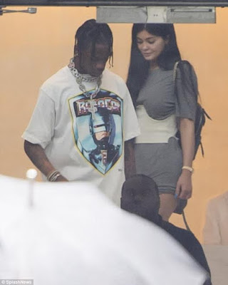 dcd5c67aef8 Kylie Jenner puts her legs on display in a tiny grey mini dress as she  spends time with Travis Scott in Miami