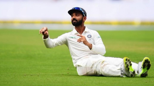 Ajinkya Rahane seating on the ground