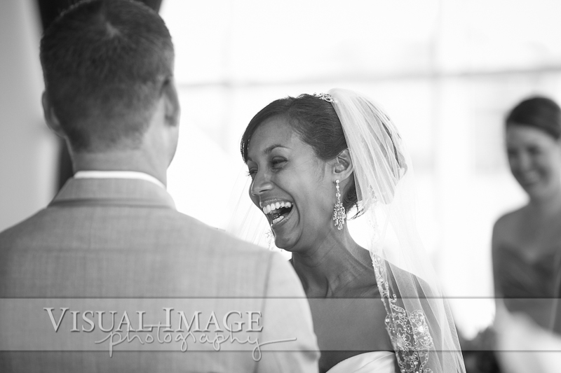 Bride laughing and crying during wedding ceremony