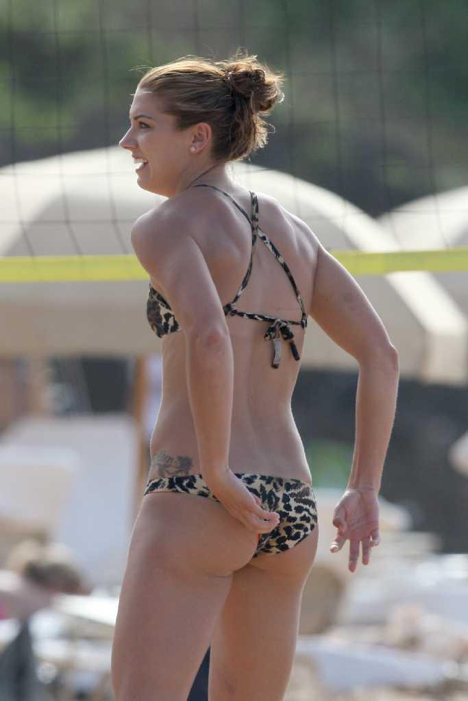 Retro Bikini Alex Morgan plays beach volleyball by a