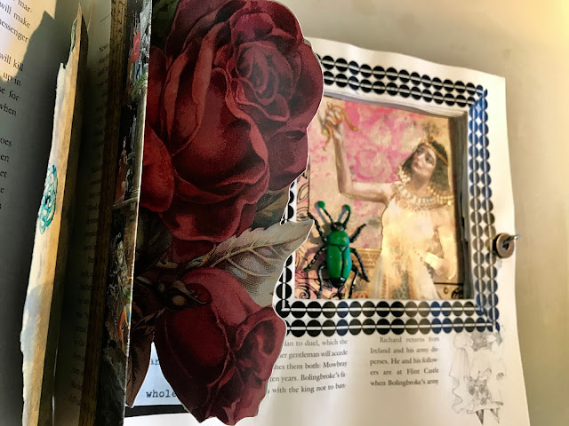 Altered page with Cleopatra, beetle, and roses