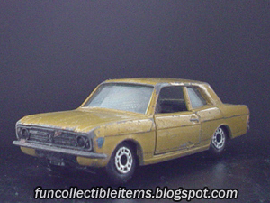 Orange Ford Cortina toy car vehicle