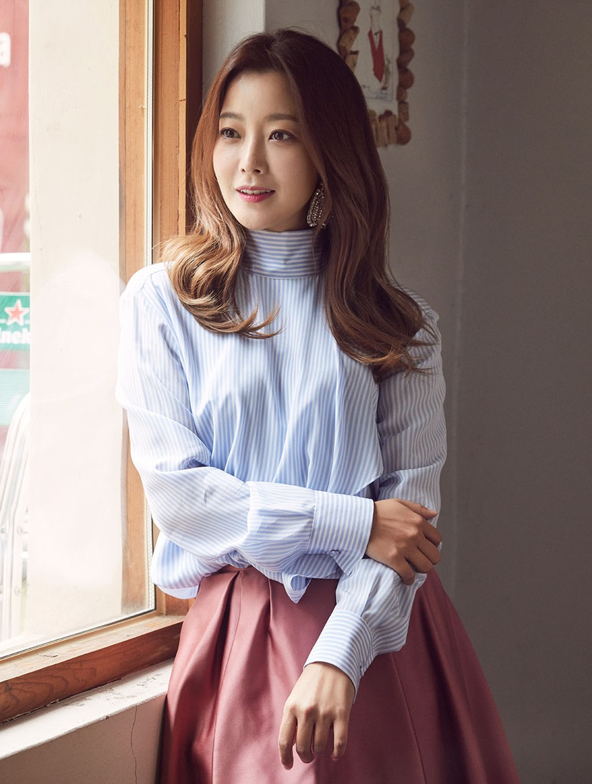 Kim Hee Sun Poses with Elegance for Woman Sense Magazine