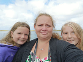 Mum & daughters on a boat
