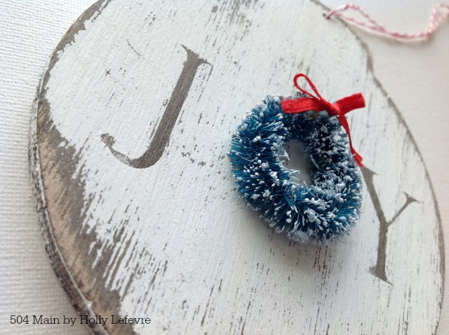 Wood Joy ornaments accented with a wreath