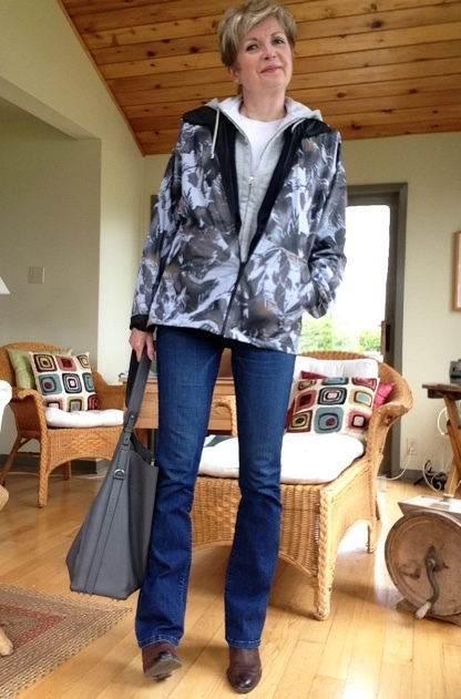 jeans, boots and a camo windbreaker