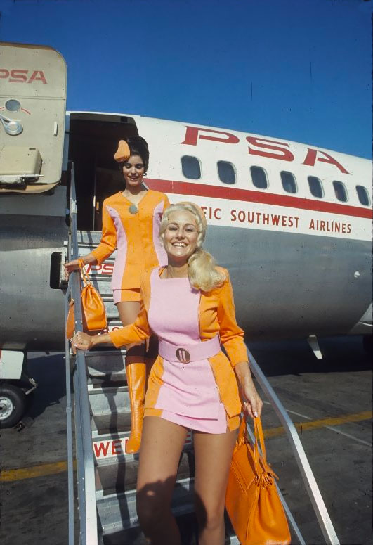 image Sexy stewardess with beautiful legs in pantyhose