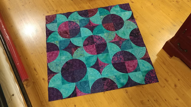Fizzy block modern quilt using purple and teal Island Batik fabrics