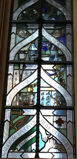 Pic of small window commemorating Women's suffrage