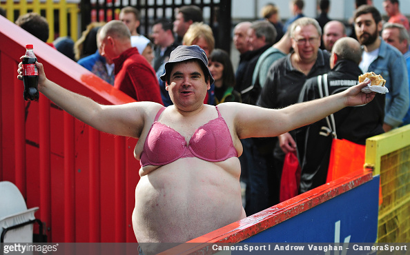 A Lincoln City fan is seen wearing a bra prior to a match against Stevenage