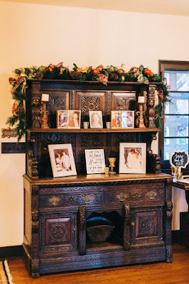 wooden prop with photos of bride and groom