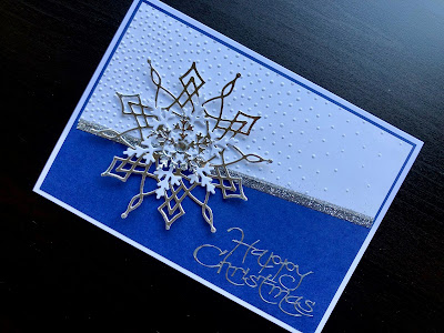 Hand made Christmas card with silver die cut snowflake, embossed background, glitter strip and peel off greeting