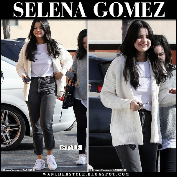 Selena Gomez in cream cardigan, graphic tee, black jeans and white puma sneakers street style december 22