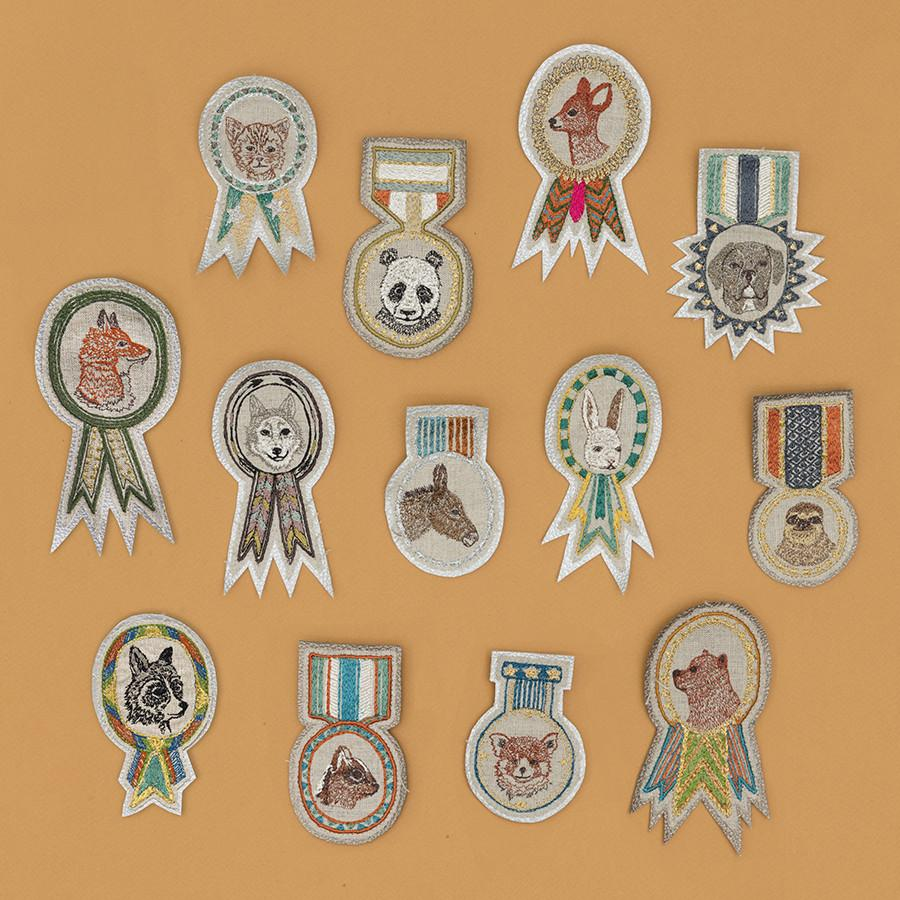 Merit badges by Coral and Tusk, featured by Julia Titchfield on Feeling Stitchy
