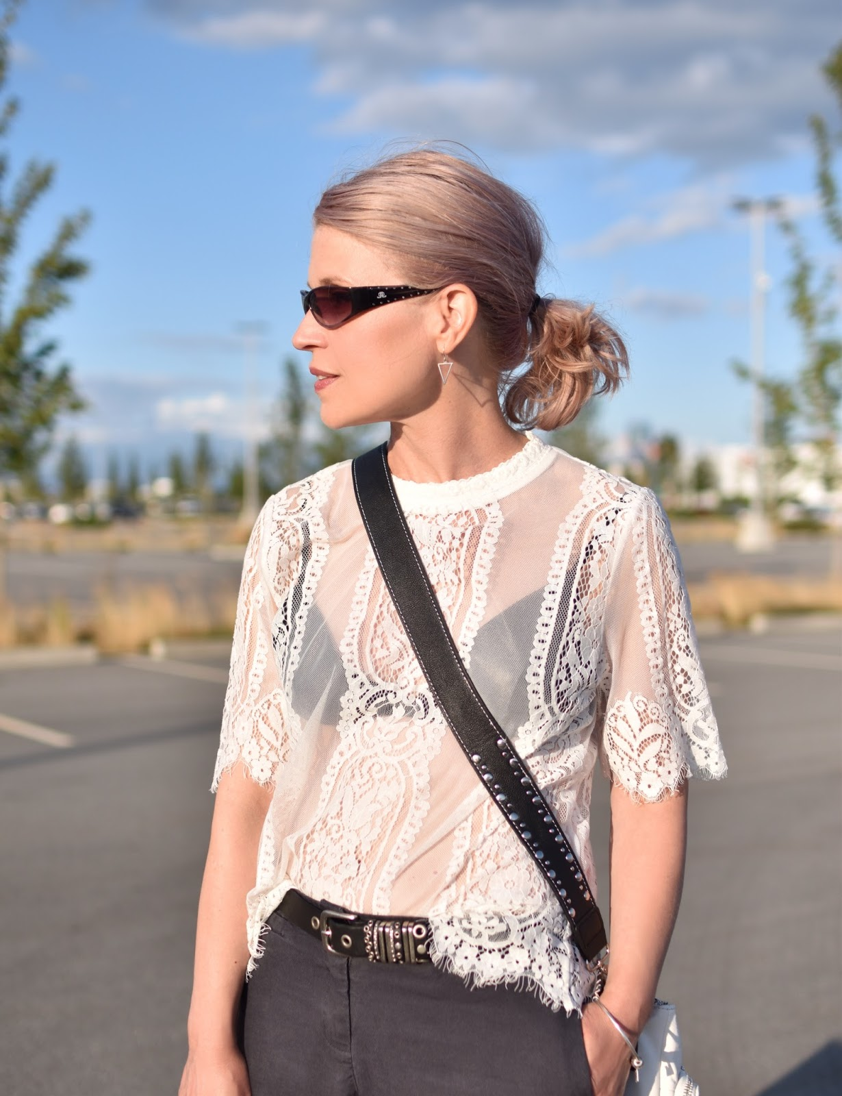 Monika Faulkner outfit inspiration - sheer lace top, cross-body bag, JLO sunglasses
