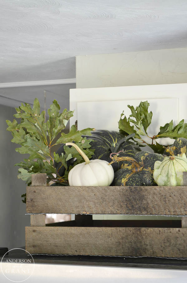 Pumpkins and gourds spilling out of a vintage wood crate. | www.andersonandgrant.com