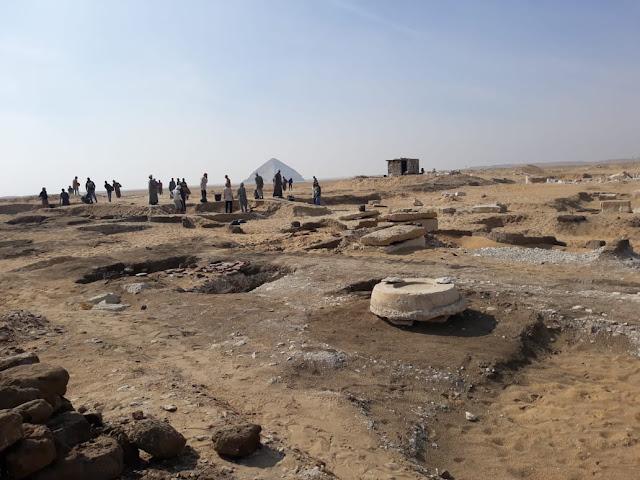 Eight limestone sarcophagi with mummies found near Giza's Great Pyramids