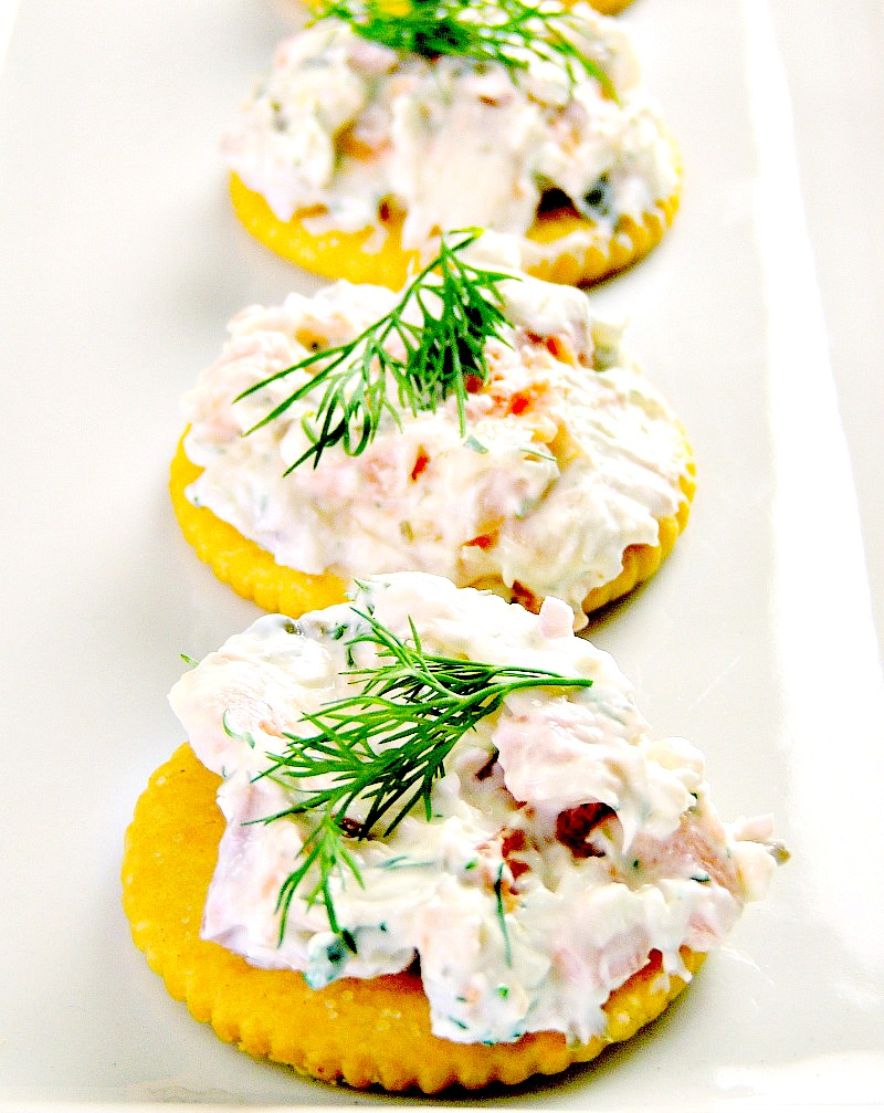 Smoked Salmon appetizers on a white serving tray.