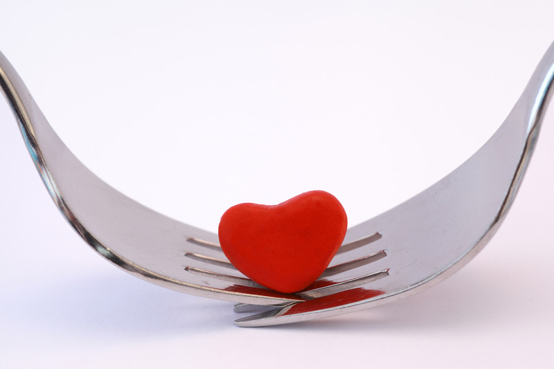 Two forks together with a love heart