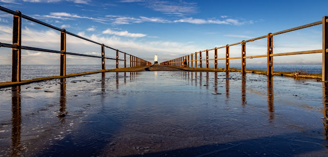 Photo of blue sky reflected in the ice on Maryport Pier