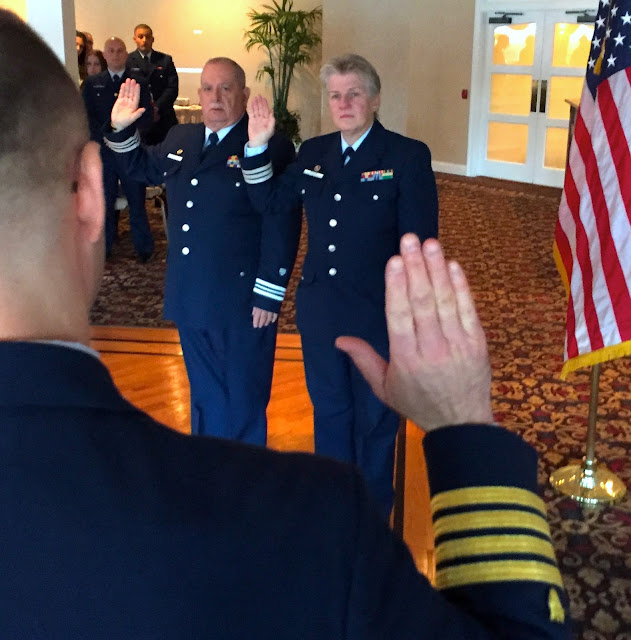 Auxiliarists Noreen Schifini DCDR and Paul Casalese VCDR take the pledge for elected officers administered by CAPT Scott Anderson USCG