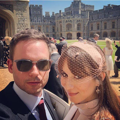 Royal wedding fashion. Troian Bellisario wearing  a Temperley London dress and matching peach colored headband with front netting. Pictured with husband Patrick J Adams