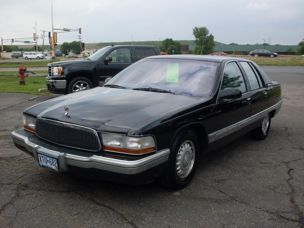 Buick Roadmaster Black on 2002 Dodge Durango White