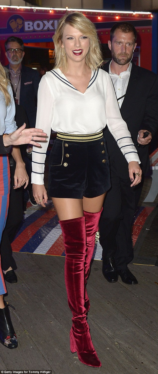 Taylor Swift arrives for Gigi's Tommy Hilfiger Fashion Show in a nautical outfit